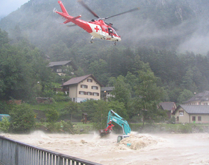 The Agusta A 109 K2 rescuing a digger operator from the River Reuss