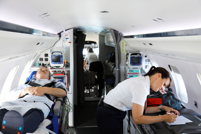 Medical crew and patient in the cabin of Rega's ambulance jet