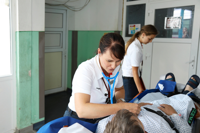Flight physician taking care of patient at the hospital