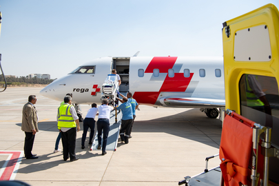 Switzerland bound: at Cairo Airport, the transport incubator carrying premature baby Emilia is pushed up the ramp into the Rega ambulance jet.
